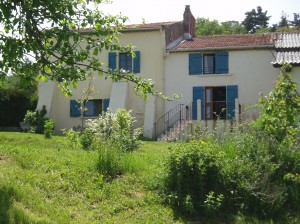 The house seen from the garden - two comfortable gites with a large garden, pool and huge views, in the heart of the french Auvergne region.